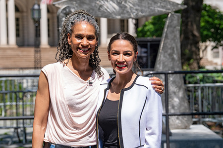 Mayoral candidate Maya Wiley and United States Congresswoman Alexandria Ocasio-Cortez pose with City Hall in background in New York City.   Representative Alexandria Ocasio-Cortez, one of the most prominent left-wing leaders in the country, endorsed Maya D. Wiley in the race for New York City mayor.   Representative Ocasio-Cortez's endorsement may cement Ms. Wiley as the left-wing standard-bearer in the New York City mayor's race.