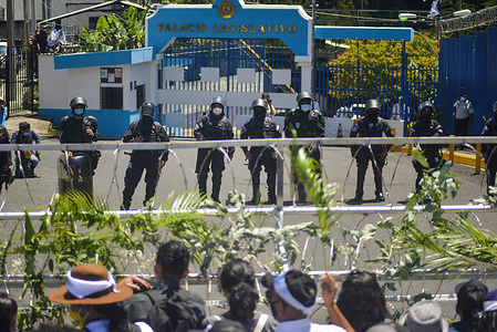Riot control police officers guard the main entrance into the Salvadoran Legislative Assembly during the demonstration. Members of churches and social movements took to the streets to protest for the environment, the Salvadoran Congress archived hundreds of law projects including several proposals for the environment and water as a human right.