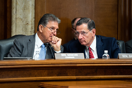 U.S. Senator Joe Manchin (D-WV) speaking with U.S. Senator John Barrasso (R-WY) at a hearing of the Senate Energy and Natural Resources committee at the U.S. Capitol.