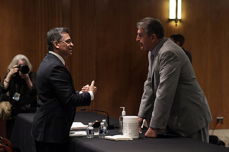 US Secretary Department of Health and Human Service, Xavier Becerra talks with Senator, Joe Manchin (D-WV) before the hearing examining the proposed budget estimates and justification for 'FY22 Budget for the Department of Health and Human Service', at Dirksen Senate Office Building/Capitol Hill.
