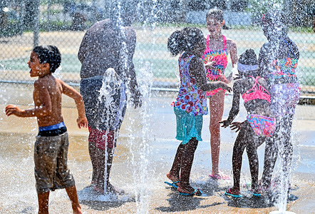 Children seen playing at a city sprinkler pad. Weather in the Northeast has been above average, with temperatures topping out at 89 degrees as many schools have let out for the summer and children are heading to parks and pools to keep cool. Temperatures should be down to average by the week's end.