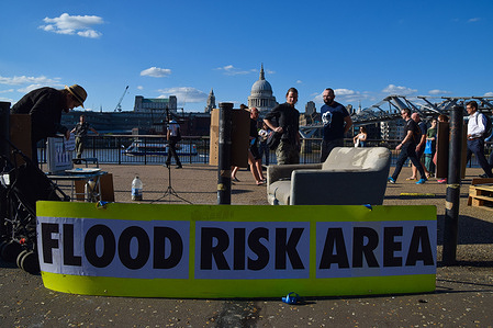 Flood Risk Area placard seen during the G7 protest. Extinction Rebellion activists gathered outside Tate Modern as part of the wider G7 climate change protests, and to raise awareness of rising sea levels and flooding due to global warming.