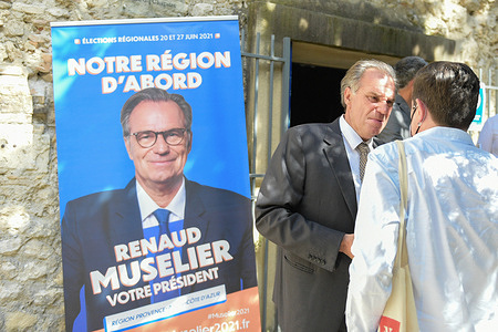 Renaud Muselier talks with a supporter  during his campaign for the regional elections.Renaud Muselier is a member of the Les Republicans (LR) party and president of the SUD region. He is running for his own succession in the regional elections to be held on 20 and 27 June 2021. He is strongly threatened in this election by Thierry Mariani, representative of the far right party Rassemblement National (RN). Renaud Muselier made a deal with the governing party (LaRem) in this election, which displeased the leaders of the LR party.