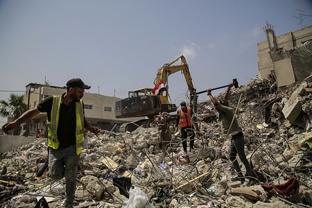 Palestinian workmen break rubble from a building destroyed during the May 2021 conflict between Hamas and Israel. The process of recycling the rubble of the destroyed buildings nearly three weeks ago in Gaza to block stones useful for reconstructions in the future is underway.