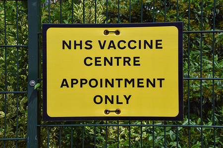 NHS covid-19 Vaccine Centre sign seen in Wembley, London.  Over 70 million coronavirus vaccination doses have been given in the UK to date, and over half of the adults have received their second dose.