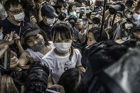 Agnes Chow (C) walks through the media pack after being released from the Tai Lam Correctional Institution. Pro-democracy activist Agnes Chow was released from prison after serving nearly seven months for her role in an unauthorised assembly during the city's 2019 anti-government protests.