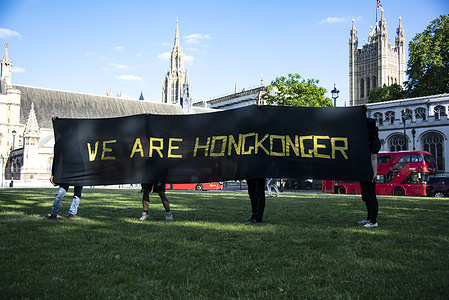 """Activists hold a large banner saying, we are Hong Konger, during the demonstration and commemoration. The Justitia Hong Kong commemorate the """"612"""" Second anniversary in Parliament Square which saw the Hong Kong Government introduce the Fugitive Offenders amendment bill to the Legislative Council for a second reading despite mass opposition."""