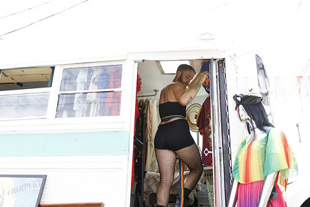 Taylor Grindle, 26, of Columbus, Ohio walks onto the SoHud Collective bus during a pride event. SoHud Collective, the South Hudson Collective, organized an event featuring DJ GVNR in SOHUD to Celebrate LGBTQ Pride and to raise money for The Trevor Project. The Trevor Project is a crisis intervention and suicide prevention service for LGBTQ youth.