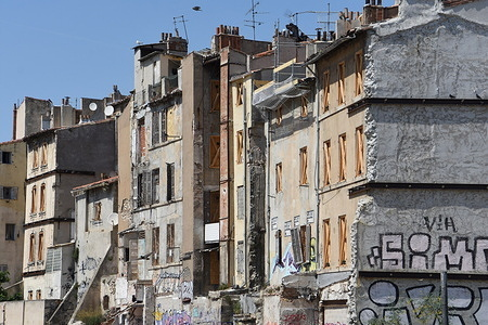 """Remains of a building and facade of a dilapidated building """"rue de la Joliette"""" in Marseille."""