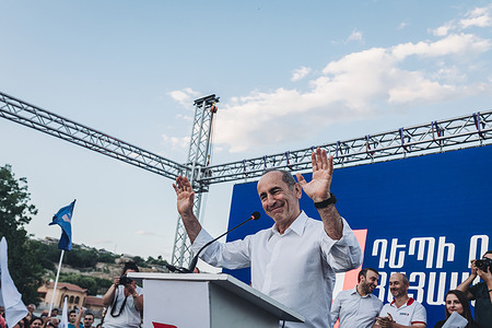 Robert Kocharyan, candidate of the Armenia Alliance party for the parliamentary elections in Armenia, salutes with his hands during a rally in Yerevan.