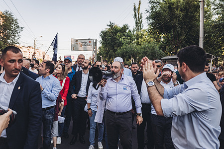Nikol Pashinyan, main candidate of the Civil Contract party for the parliamentary elections in Armenia speaks through a megaphone to his supporters during a march through the streets of Yerevan.