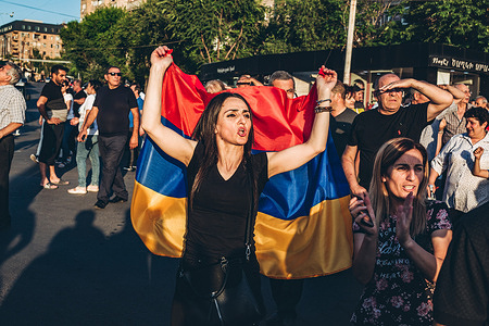 A supporter of Nikol Pashinyan  main candidate of the Civil Contract party for the parliamentary elections is seen with the Armenian flag during a rally in Yerevan.