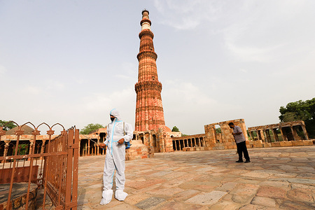 A worker wearing a Personal Protective Equipment suite (PPE) chemically disinfects the premises of the Qutub Minar complex ahead of its reopening to the public after the lockdown in New Delhi. Indian Statistical Institute (ASI) Protected monuments and museums are scheduled to reopen from June 16th. Delhi has over 70 monuments under ASI, including Red Fort, Humayuns Tomb, Qutub Minar and Purana Qila.