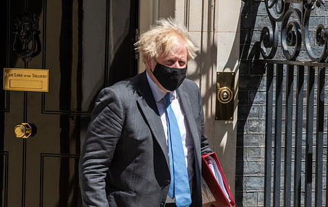 British Prime Minister Boris Johnson seen leaving Downing Street to attend the PMQ's (Prime Ministers Questions)  in London.