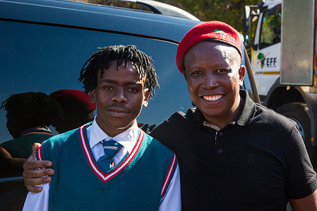 Julius Malema (R), member of the National Assembly of South Africa with Katlego Legodi during the EFF June 16 commemoration outside Uitsig High School. Katlego Legodi a learner at Uitsig High School was assaulted by a racist security guard for wearing an EFF (Economic Freedom Fighters) regalia at a school career day.