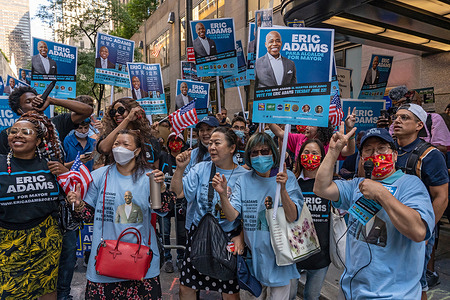 Supporters of mayoral candidate Eric Adams cheer, before the third televised debate for the New York City mayoral race, outside the NBC studios.