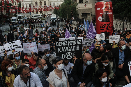 Protesters hold placards during a demonstration. People held a protest against Armed Attack on Peoples' Democratic Party Izmir Office, the armed attacker Onur Gencer, who came to the headquarters of the pro-Kurdish Peoples' Democratic Party in Izmir at around 11:00 am today, killed a 40-year-old employee Deniz Poyraz.  The gunman, who randomly shot around with a gun, was later caught by the police and taken into custody.  In his first statement, the attacker said that he carried out the attack because he hated the Kurdistan Workers Party and that he planned to kill more people.