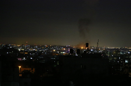 Flames and smoke are seen after an Israeli air strike in the northern Gaza Strip. Israel attacks many of the Palestinian military sites after masked Palestinians launching incendiary balloons towards Israel across the border fence between Gaza strip and Israel to set fire at the Israelis farms as a protest to the siege by Israel on the Gazans.