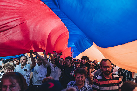 Supporters of Robert Kocharyan seen under the Armenian flag during the Armenia Alliance political party rally at the Republic square.