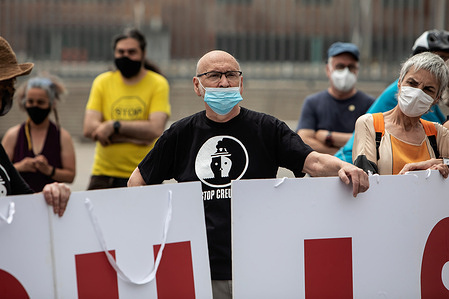 Protesters hold placards during the demonstration against the return of the cruise ships after the pandemic.