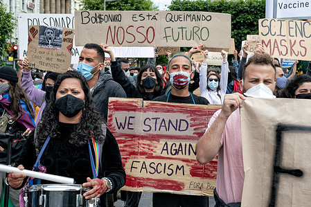 A group of young Brazilian protestors holding placards expressing their opinion, during the demonstration.A number of protestors, mostly from the Brazilian diaspora in Dublin, gathered in front of the GPO (General Post Office) on O'Connell Street demonstrating against Brazilian president, Jair Bolsonaro and his handling of the Covid 19 pandemic calling for Bolsonaro's impeachment and for provision of vaccinations. Gino Kelly, TD (member of Irish Parliament) from the People Before Profit party also gave a speech showing Irish solidarity with the movement.