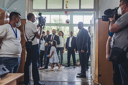 Nikol Pashinyan waits to cast his vote at a polling station in Yerevan during the parliamentary elections.
