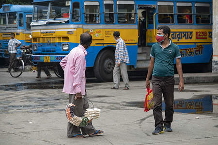 A bus hawker seen waiting for bus in a city bus terminus as bus, auto, toto services have been resumed. The west Bengal Govt has relaxed some lockdown rules and restrictions effective from 1st July to 15th July. Bus, auto, toto services have been resumed as well as the opening of gyms, parlours and saloons, although still restricted to50% occupation. However local trains and metro services will remain closed until further notice.