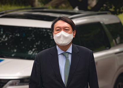 South Korean former Prosecutor General Yoon Seok-Youl, who has announced his intention to run in next year's presidential election as an opposition candidate, arrives at Seoul National University for a press conference.South Korean President Moon Jae-In selected Yoon in July 2019 to lead the national prosecution service but Yoon later clashed with president Moon government's justice ministers over a prosecution reform drive which was one of Moon's major presidential election pledges. Yoon stepped down as prosecutor general in early March 2021. Yoon is one of leading candidates for the next presidential election of South Korea.