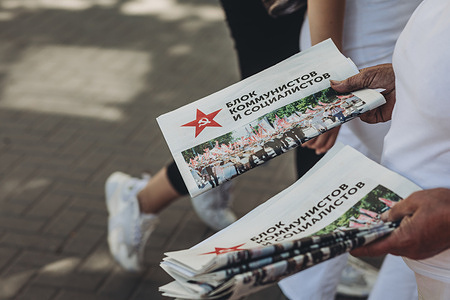 Propagandistic newspaper of the coalition Bloc of socialists and communists integrated by PCRM (Communist Party of the Republic of Moldova) and PSRM (Socialist Party of the Republic of Moldova). Election campaigns going on in the streets of Chisinau for Moldova's parliamentary elections.
