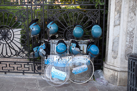 Helmets and equipment of the Italian riot police are hanged on a fence, as police wait for the anti G20 protest to take place on the seaside of Venice (Zattere).