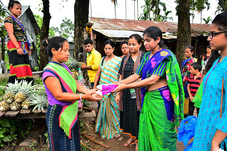Health workers are distributing free sanitary pads to the tribal women and girls and explaining to them the necessary of using it, in a health camp.  Man local women are not using sanitary pads as they are too expensive for them to afford.