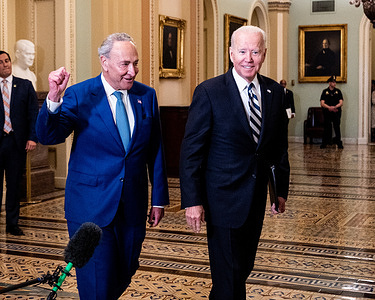 President Joe Biden and Senate Majority Leader, Chuck Schumer (D-NY) walking near the Senate Chamber as the President arrives for a lunch with Senate Democrats at the U.S. Capitol.