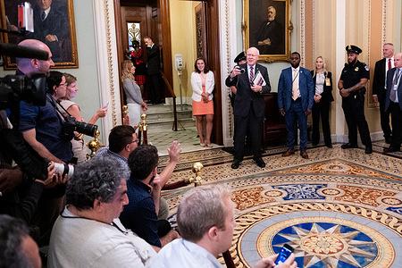 U.S. Senator, Patrick Leahy (D-VT) taking a photo of the press gathered near the Senate Chamber at the U.S. Capitol.