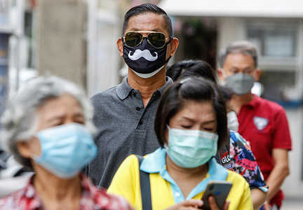 People wearing face masks wait to be vaccinated with the Chinese-made COVID-19 vaccine Sinopharm at Siriraj hospital in Bangkok. There were 67 Covid-19 fatalities and 9,692 new cases over the past 24 hours, the Public Health Ministry reported on Friday morning.