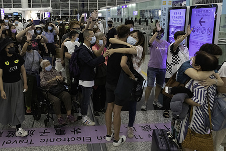 """People farewell their friends and families as they depart to the UK.As the deadline of """"Leave outside the Rules"""" (LOTR) for BN(O) visa expires on July 21, there is a special allowance for HongKongers to apply for visa after landing in UK. The last two days, HongKongers rushed to leave their beloved city to immigrate to UK in different mood, Excited for future or hugging each other and weeps. Thousands of Hong Kongers are expected to leave for the UK and other democracies, as the city has been facing intensifying crackdown on human rights and freedom following China's National Security Law, with impacts on its economy amid the COVID-19 pandemic."""