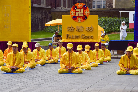 Falun Gong practitioners meditating during the protest. Practitioners and supporters gathered outside the Houses of Parliament to protest against the Chinese government's persecution, according to the protesters, of Falun Gong (also known as Falun Dafa) meditation practitioners, through abductions, imprisonment, torture, and organ harvesting.