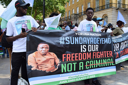 Demonstrators hold a pro-Sunday Igboho banner during the Yoruba Nation protest.Nigeria's Yoruba Nation supportersgathered outside Downing Street to demand the release of activist Sunday Adeyemo, also known as Sunday Igboho, who was recently arrested in Benin.