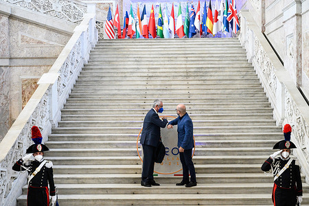 Roberto Cingolani (R) seen greeting a guest according to Covid-19 safety measures during the meeting. During the Italian Presidency of the G20, the Environment, Climate and Energy Meeting had been organized in the Royal Palace in Naples. The Environment Ministerial Meeting, chaired by Minister for Ecological Transition Roberto Cingolani, had been scheduled for the first day. Environmental issues and challenges had been addressed by G20 representatives as well as International Institutions.