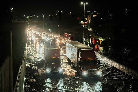 Vehicles cautiously drive through floodwaters on I-94 following a severe storm system that caused flash flooding on main roadways in Detroit.Severe storms across South East Michigan caused major damage and significant flooding in parts of Detroit and surrounding areas for the third time in a month. Multiple highways were shut down due to floodwaters and residents reported a tornado damaging part of Armada, Michigan.