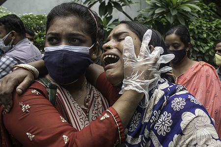 A woman breaks down in tears while waiting to receive the body of her loved one who died in the deadly fire that had engulfed a Narayanganj factory last month.The authorities have handed over the remains of 21 bodies of the workers, who died in the Hashem Foods Ltd factory fire at Rupganj of Narayanganj on July 8, to their families on Saturday. The charred bodies were released from 12pm to 1pm after the forensic unit of the police's Criminal Investigation Department (CID) identified 45 out of 48 deceased workers through DNA analysis. However, CID is yet to confirm the identities of three more bodies.