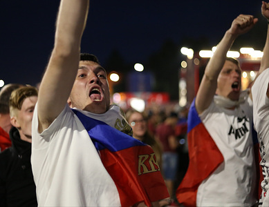 A man is seen raising his hands celebrating the Russian win. Russians fans celebrate the victory of their team who beat Egypt (3-1) during the Russia's 2nd Group A match at the FIFA world cup 2018