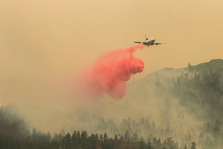 A DC-10 Air Tanker drops fire retardant over the Dixie fire.A spot fire from the Dixie Fire spreads to the highway 395. Cal Fire reports that the Dixie Fire has now grown over 700,000 acres. The cause of the fire is still being investigated.