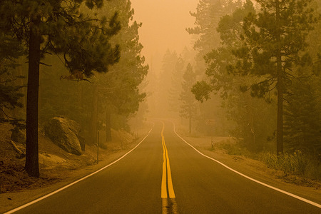 Smoke fills the air from the Caldor fire choking highway 50.  The Caldor fire has grown to over 150,000 acres and threatens to grow to the Tahoe basin. The fire has reached the town of Strawberry.