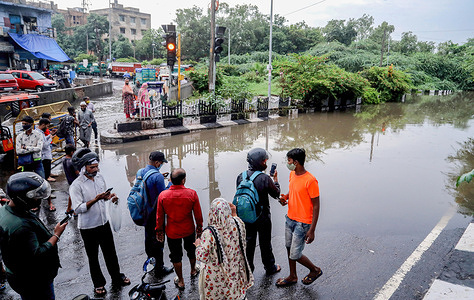 People taking photographs of a flooded road at Zakhira underpass during the aftermath. Flooding caused severe traffic delay in the different roads. Delhi recorded 112.1 mm rainfall during the last 24 hours and it is the highest in past 19 Years. Indian Meteorological Department (IMD) issued orange alert in Delhi. The temperature dropped due to the continuous rainfall in the Capital.