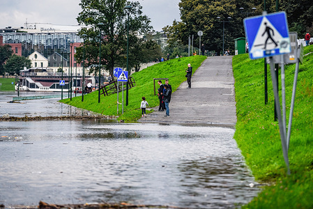 People are seen along the Vistula Boulevard under floodwater due to heavy rainfall.After the heavy rains in Malopolska, the Vistula river that crosses Krakow rose and as a consequence the boulevards are flooded, some walking paths disappeared under water. The Flood alert remains as heavy rain forecast continues in the region.