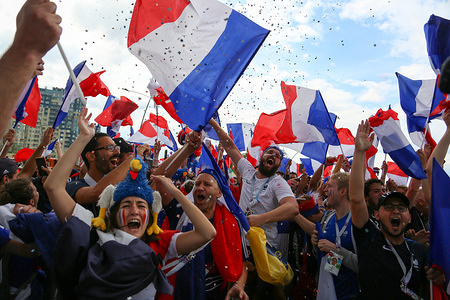 French football fans seen celebrating with their national flags. French football fans celebrate their national football team victory over uruguay during the quarterfinal match of the Russia 2018 world cup finals.