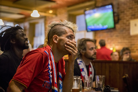 Russian football fan reacts while watching penalty kicks against Croatia during the 2018 World Cup game he is watching on television at the Uptown Cafe. Russian lost to Croatia 4-3 in penalty kicks.