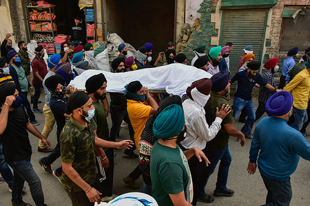 (EDITORS NOTE: Image depicts death) Sikh mourners carry the dead body during a funeral procession of slain Supinder Kour. The principal and teacher of a government school were killed by unknown gunmen suspected to be militants in Srinagar, the latest in a spate of targeted killings in the Kashmir valley. The attack comes less than 48 hours after three persons were shot dead in strikes. The victims were from Sikh and Hindu communities. The teacher, Deepak Chand, was a Hindu from Jammu and the principal, Supinder Kour, was a Sikh.