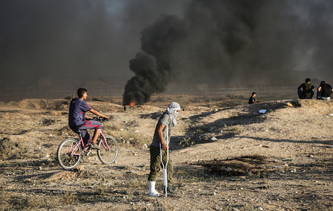 A wounded Palestinian man is seen among protesters. A demonstration by the Palestinian citizens along the border with the Gaza strip east of Gaza city.