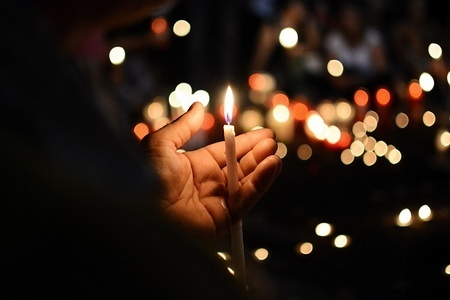 A candle seen during the vigil service. Hundreds of people gathered in Syntagma Square to join the vigil service for the victims of the Attica wildfire which claimed 88 lives.